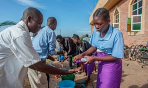 Parishoners wash hands as a preventive measure against the spred of the COVID-19 coronavirus on the last day of full gatherings as a parish at the Saint Don Bosco Catholic Parish in Lilongwe on March 22, 2020.