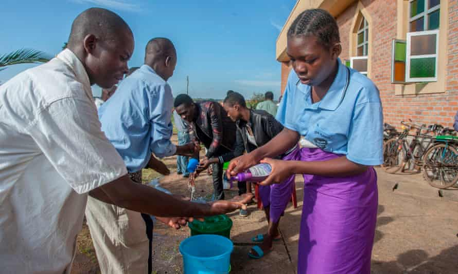 People wash their hands as a preventive measure against the spread of coronavirus on the last day that church gatherings were allowed, at a parish in Lilongwe on 22 March.