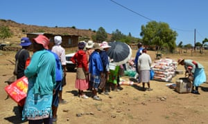 Villagers queue for food handouts in Lesotho's Mohale's Hoek district