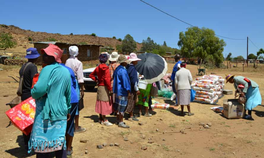 Villagers queue for food handouts in Lesotho's Mohale's Hoek district