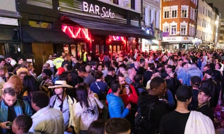 Old Compton Street crowded with drinkers in the evening
