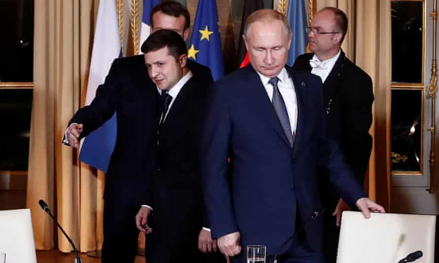 Volodymyr Zelenskiy and Vladimir Putin at the Élysée Palace, the two did not shake hands or acknowledge each other at a press conference after the meeting.