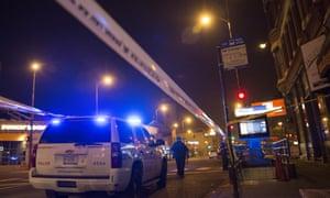 Police investigate a crime scene of a gunshot victim in Chicago.