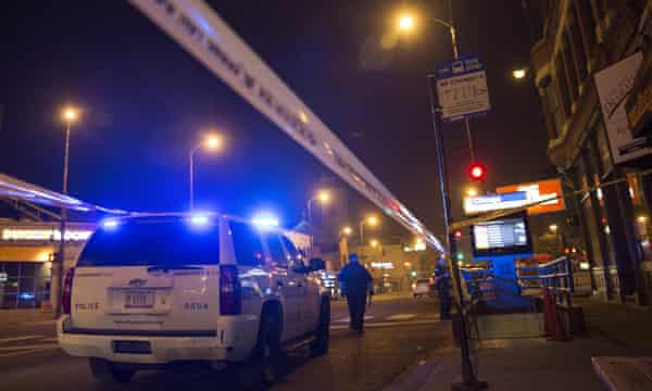 Chicago police officer investigate a crime scene of a gunshot victim.