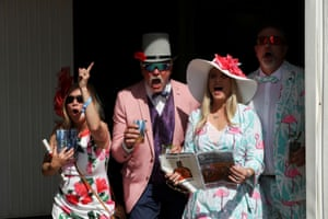 Spectators cheer for their winning horse at the Kentucky Derby