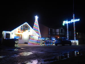 A huge striped christmas tree made of lights is known locally as the Jetty Road Christmas lights show