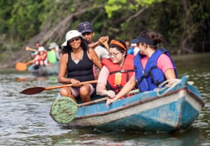 Forest COP participants travelling by canoe.
