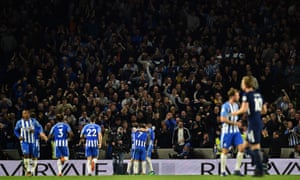 Brighton's Pascal Gross is mobbed by team-mates after equalising from the penalty spot