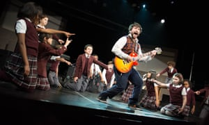 Alex Brightman, centre, in School of Rock – The Musical.