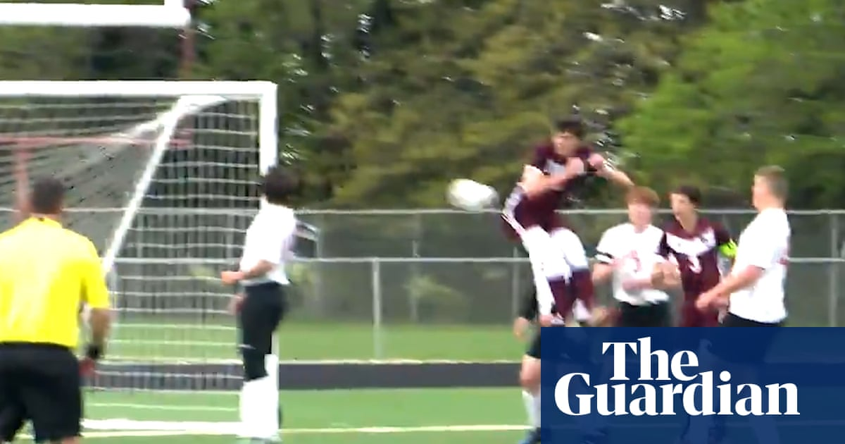 Cheeky finish: high school footballer scores 'goal of the year' with backside – video