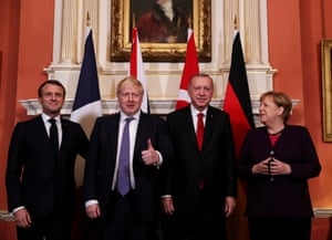 The leaders of France, Britain, Turkey and Germany pose for pictures as they meet at Downing Street before the Nato summit