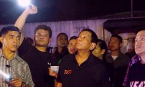 President Rodrigo Duterte visits site of fire at the shopping mall in Davao.