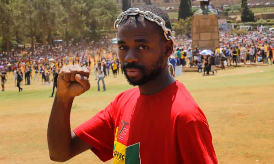 A student joins the demonstration at Pretoria's Union Buildings on Friday.