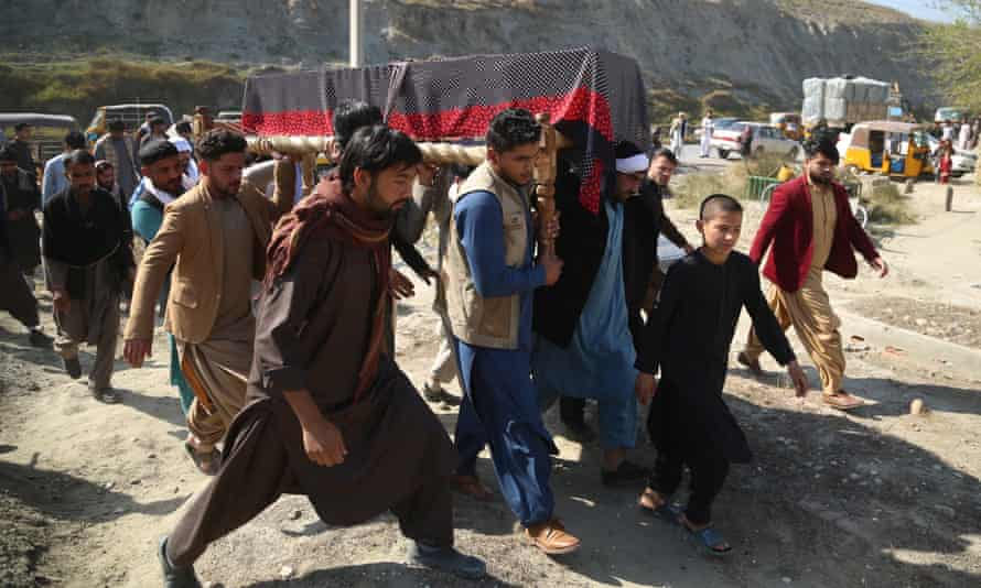 Relatives carry the coffin of Sadia Sadat, one of three female Afghan journalists killed on 2 March, during her funeral in Jalalabad.