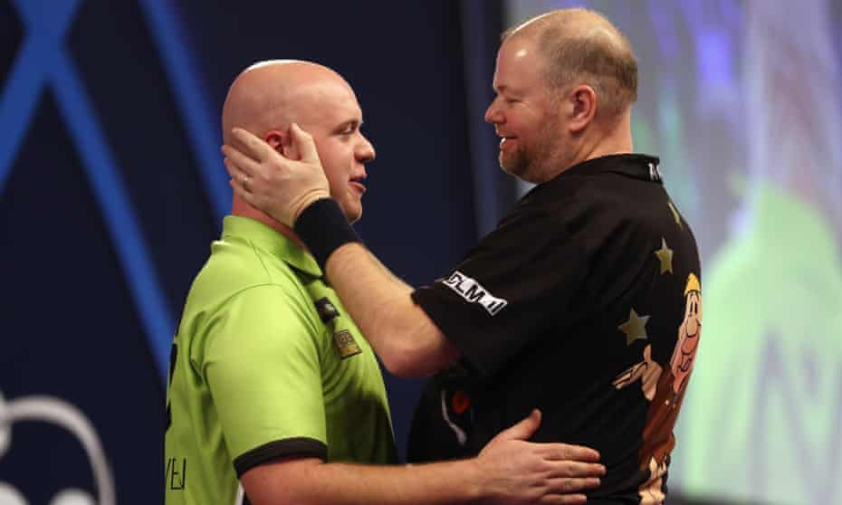 Michael van Gerwen and Raymond van Barneveld embrace after their record-breaking match at Alexandra Palace in 2017