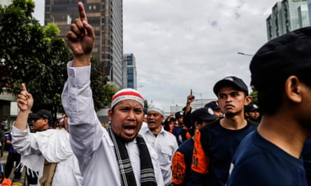 Muslim protesters shout slogans during a rally outside court during the blasphemy trial of Jakarta's governor Basuki Tjahaja Purnama, popularly known as 'Ahok'.