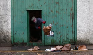A man clears out his lockup after it was flooded when the river Tweed burst its banks in Peebles, Tweeddale.