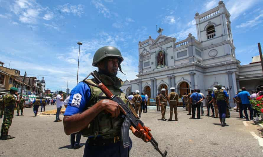 Sri Lankan security forces patrol the area around St Anthony's Shrine