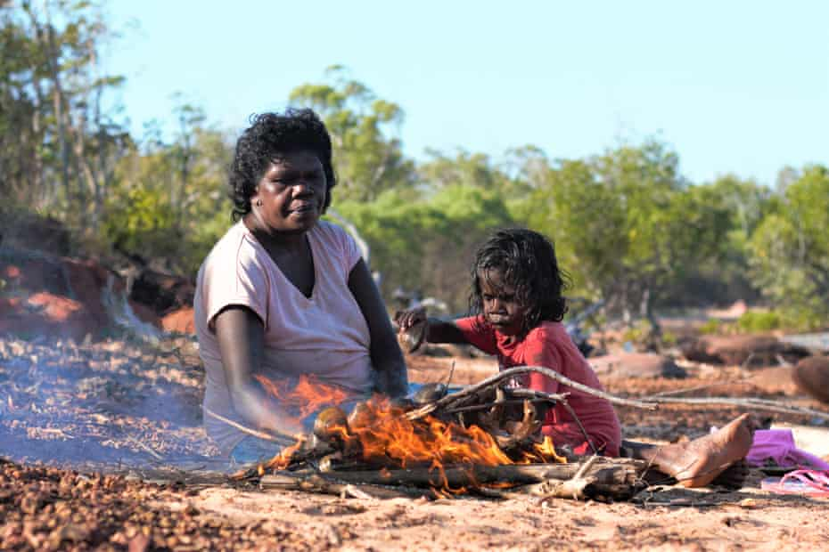 Cooking mud mussels on the beach on Elcho Island, Northern Territory.