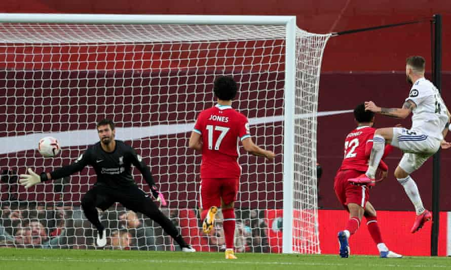 Mateusz Klich scores his side's third goal at Liverpool in Leeds's opening game