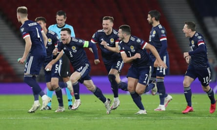 The Scotland players charge towards Kenn McLean after his winning penalty in the shootout against Israel.