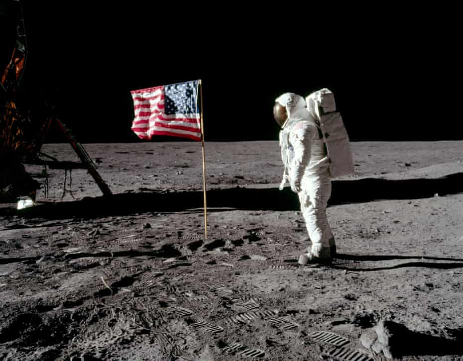 Aldrin poses next to the stars and stripes.