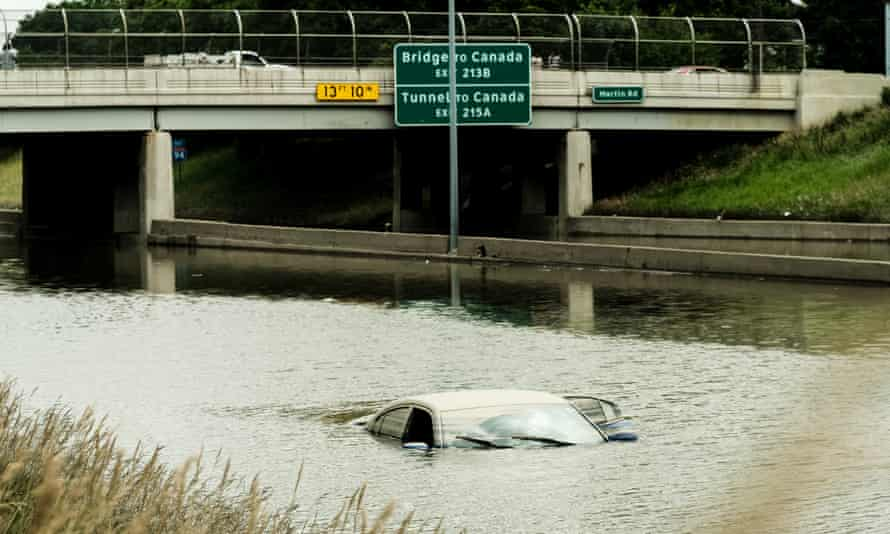 Submerged car on flooded road