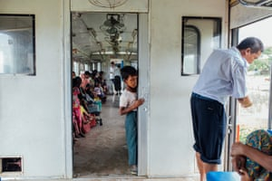A Rohingya boy watches the conductor talk to other passengers from the compartment reserved for Muslim passengers in the Sittwe-Zaw Pu Gyar train