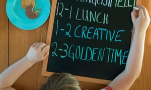 Child with a blackboard with their daily work schedule on it