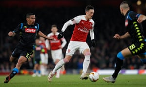 Arsenal's Mesut Ozil drives forward under pressure from Marques Loureiro and Maksimovic.