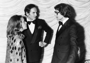 Cardin is seen with Jeanne Moreau and Yves Saint Laurent in 1970