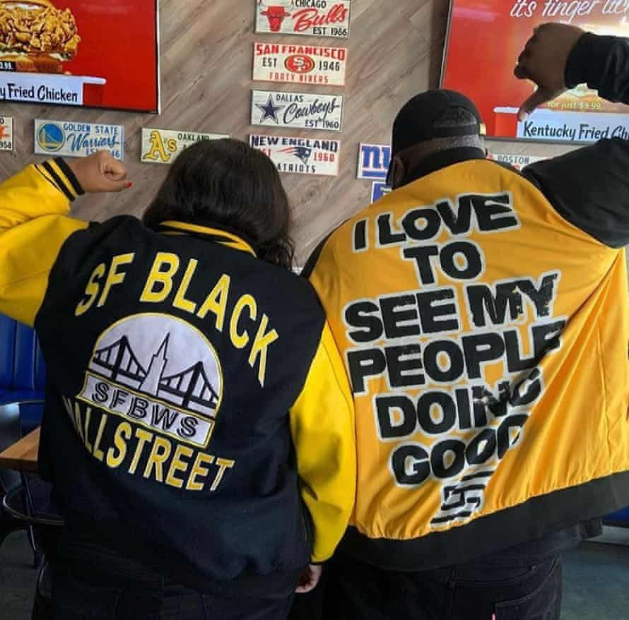 Two local residents showing off their San Francisco Black Wallstreet jackets.