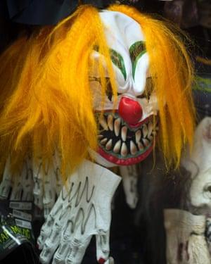 A clown mask in a fancy dress shop.