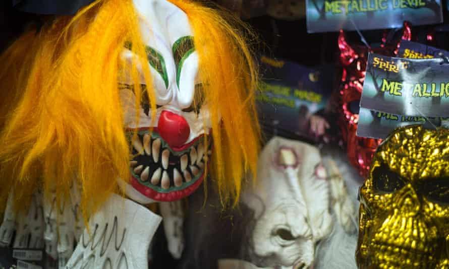 A clown mask in a shop window