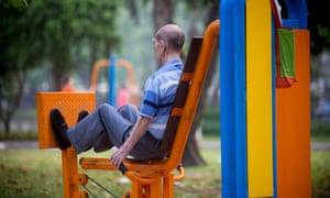 A man exercises at Lumphini Park, Bangkok