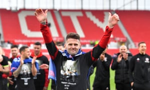 Oliver Norwood celebrates promotion to the Premier Leaguein May.