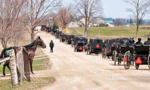 Mennonites driving horse-drawn buggies in Ontario, Canada. They reject things like government-run secular schools, voting, carrying drivers' licences or paying insurance.