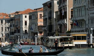 Gondoliers resume their service on the Grand Canal in Venice as Italy eases more lockdown measures.