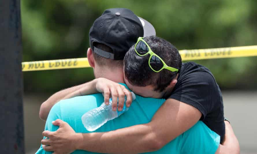 Supported by a friend, a man weeps for victims of the mass shooting just a block from the scene in Orlando, Florida, on June 12, 2016.
