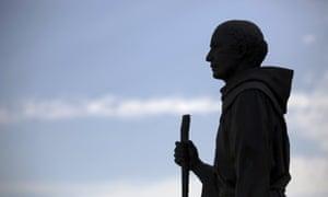 A statue of Friar Junipero Serra stands outside the Mission San Gabriel Arcangel in San Gabriel, California.