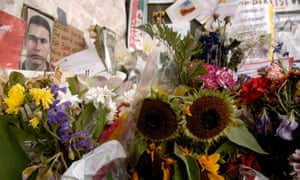 Floral tributes outside Stockwell tube station to Jean Charles de Menezes.