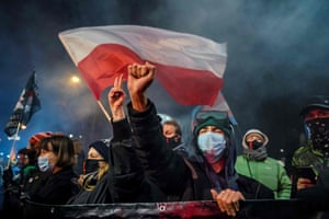 A demonstrator gestures as people take part in a pro-choice protest in Warsaw as part of a nationwide wave of protests since 22 October last year against Poland's near-total ban on abortion.