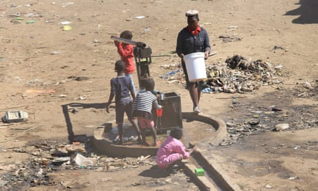 Children play at a borehole in the township of Mbare, Harare, Zimbabwe