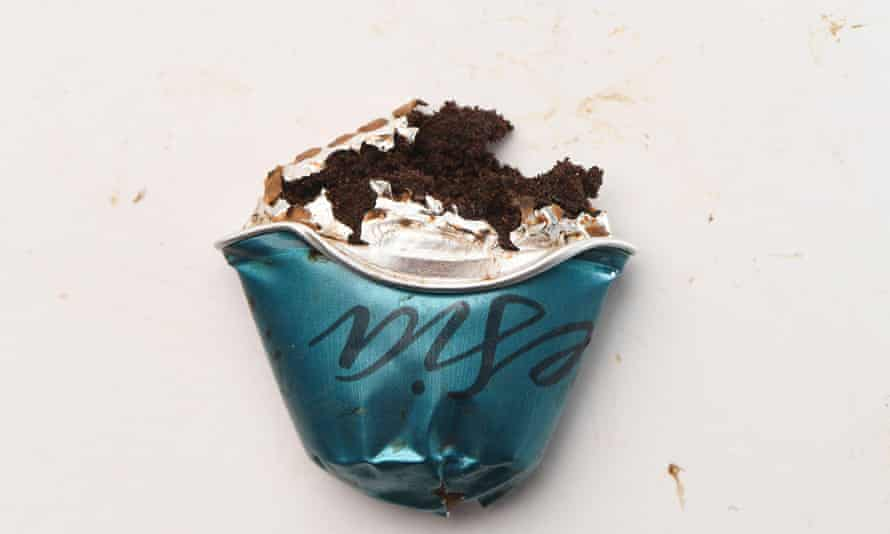 A close up of a crushed Nespresso capsule