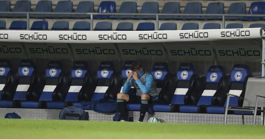 Schalke defender Timo Becker sits alone on the bench after the team were relegated.