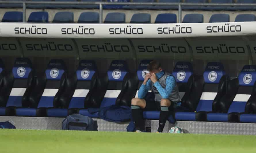 The Schalke defender Timo Becker is left in tears as the club's inevitable relegation is confirmed.