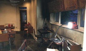 The interior of JS Restaurant in north Manchester following an arson attack.