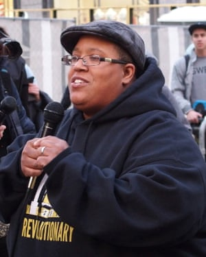 Malkia Cyril, microphone in hand