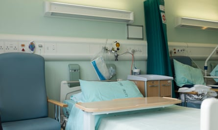 An empty NHS hospital bed on a ward