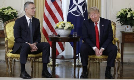 Donald Trump grimaces during a meeting with Nato's secretary general, Jens Stoltenberg, in central London.